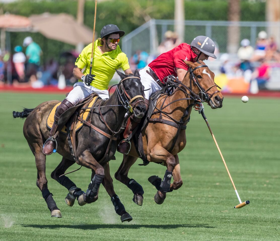 "Cameron Smith (Red Jersey) playing ""Missy"" in a polo tournament at Empire Polo Club last season."