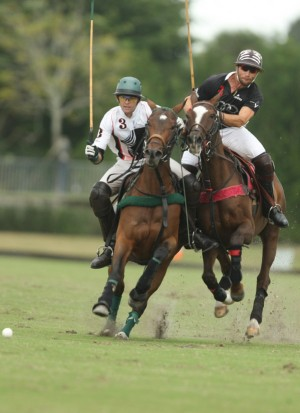 (L to R)-Julio Arellano (Postage Stamp FArm) and Sugar Erskine (Audi) battling for field position in the opening round of play of the 2015 National Twenty-Goal Championship at the Grand Champions Polo Club. (Photo by Alex Pacheco)