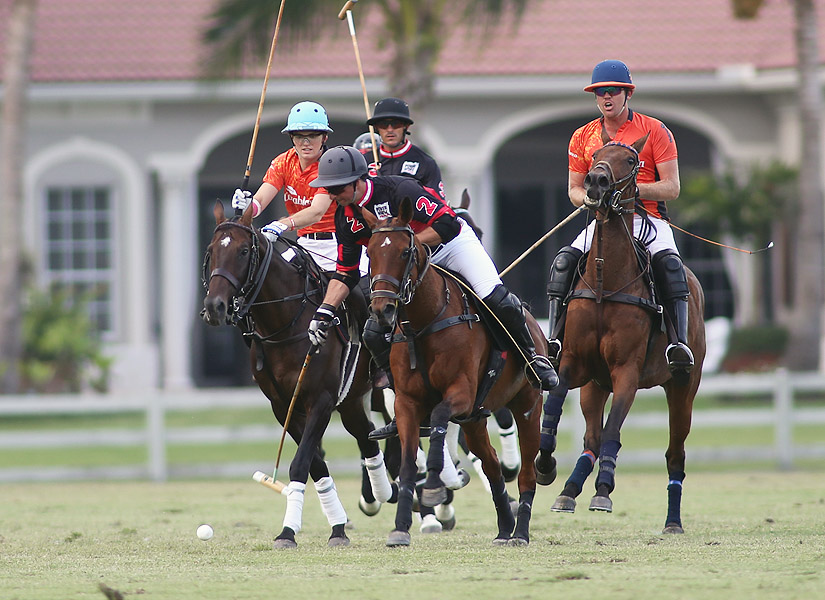 (L to R)-Grant Ganzi, Michael Bickford and Kris Kampsen on the ball in the 2016 Grand Champions Cup at the Grand Champions Polo Club in Wellington.  (Photo by Alex Pacheco)