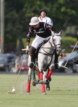 Orchard Hill 10-goaler Juan MartinNero with the ball, Mariano Obregon in pursuit for White Birch in the semifinal of the 2016 US Open at the International Polo Club.  (Photo by Alex Pacheco)