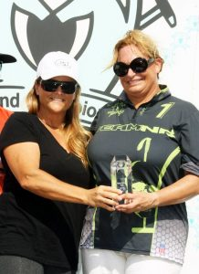 MVP Melissa Ganzi of Team NR receives her award from polo great Sunny Hale. Photo by Alex Pacheco